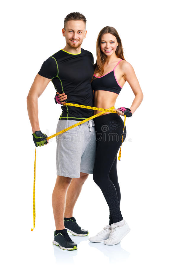 愉快的运动夫妇-男人和妇女有测量的磁带的在 免版税库存照片