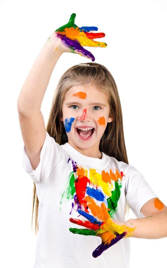 愉快的逗人喜爱的小女孩用五颜六色的被绘的手 库存照片