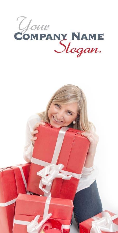 愉快的逗人喜爱的白肤金发的接受礼物 免版税库存图片
