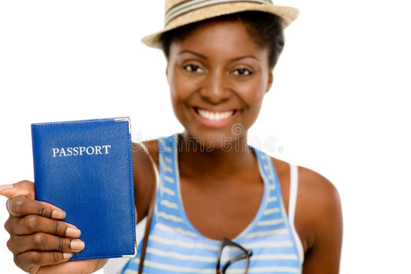愉快的非裔美国人的妇女旅游举行的护照白色背景 免版税图库摄影