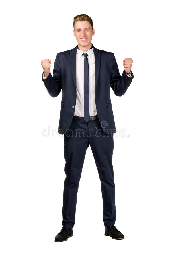 愉快的年轻商人被举的拳头 免版税库存图片