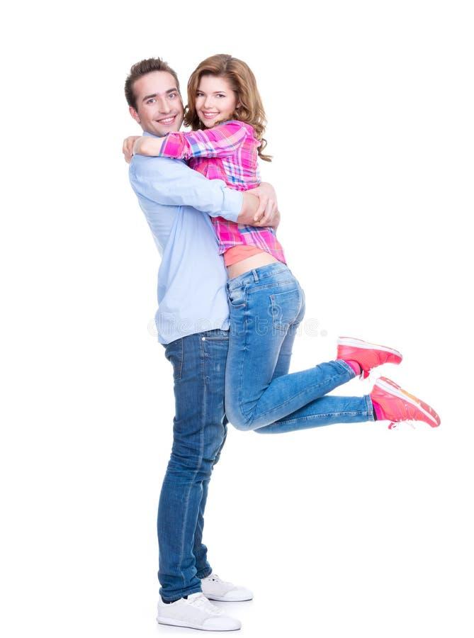 愉快的年轻夫妇充分的画象。 免版税图库摄影