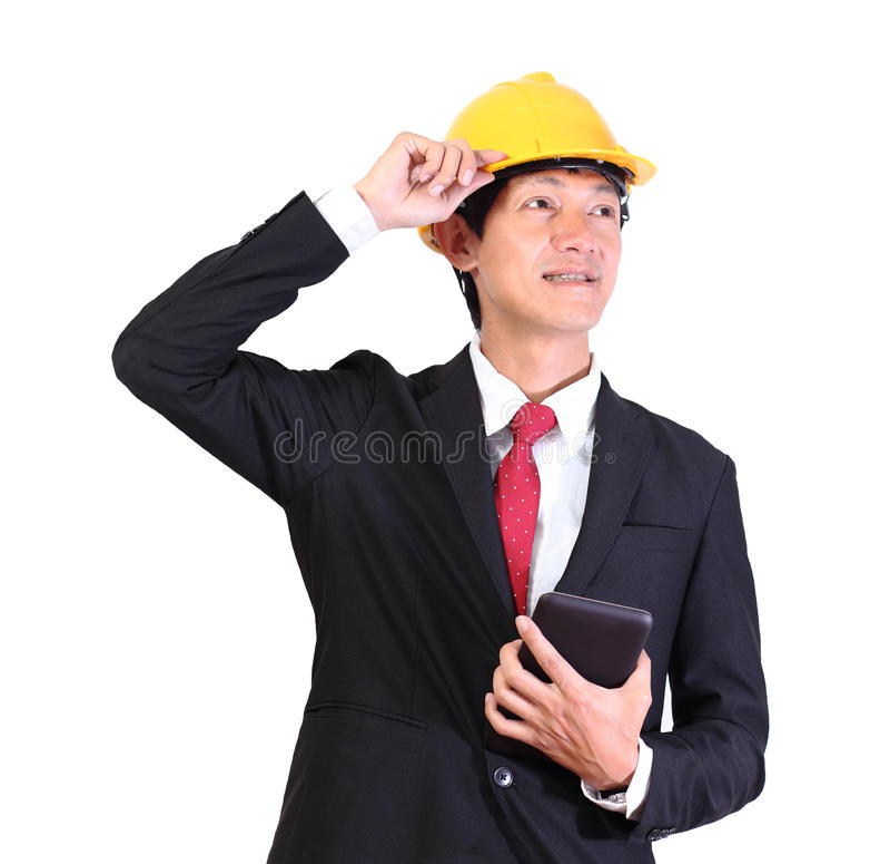 愉快的年轻工程师人画象有安全帽的在白色bac 库存照片