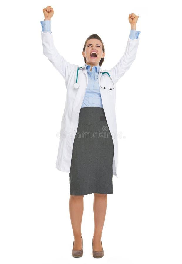 愉快的医生妇女欣喜成功全长画象  免版税库存图片