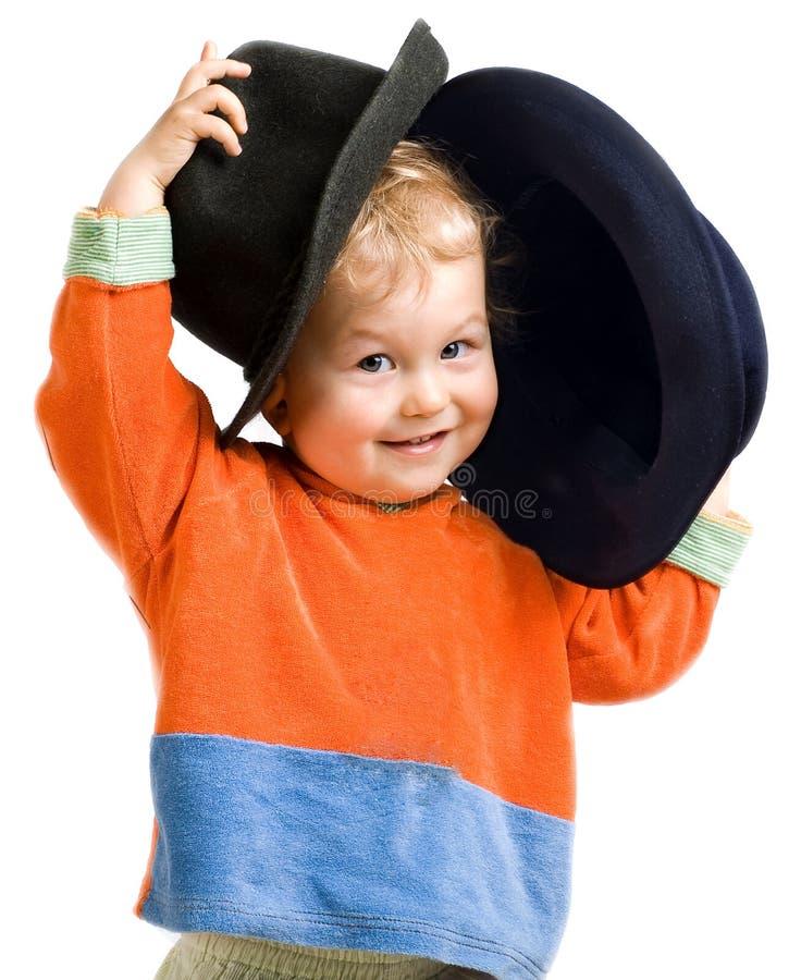 愉快背景的男孩查出空白的一点 免版税库存照片