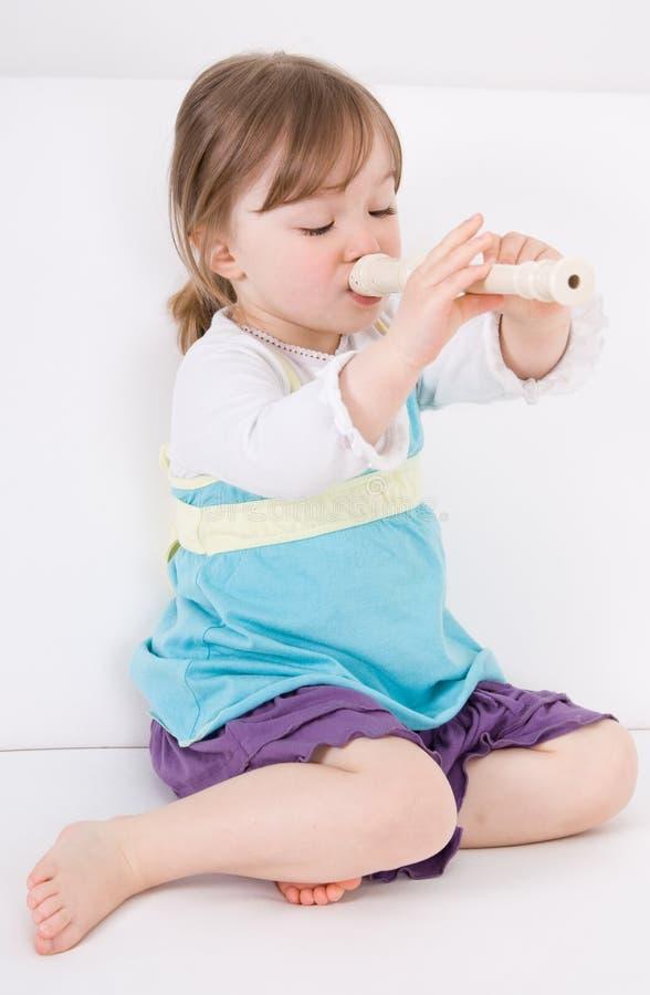 愉快长笛的女孩 库存图片