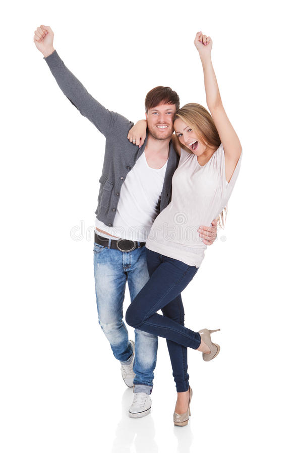 愉快年轻夫妇庆祝 免版税库存图片