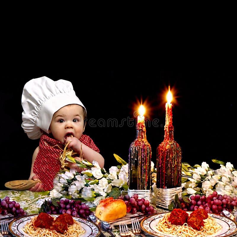 意大利晚餐的小厨师 图库摄影