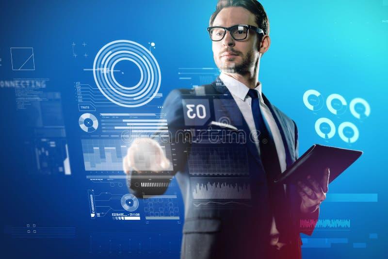 感觉的软件工程师接触透明屏幕和感兴趣 免版税图库摄影