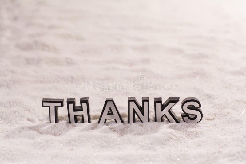 感谢在白色沙子措辞 免版税库存图片