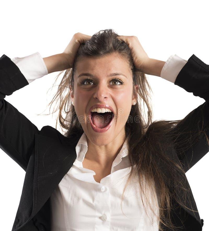 愤怒的女实业家尖叫 免版税库存照片