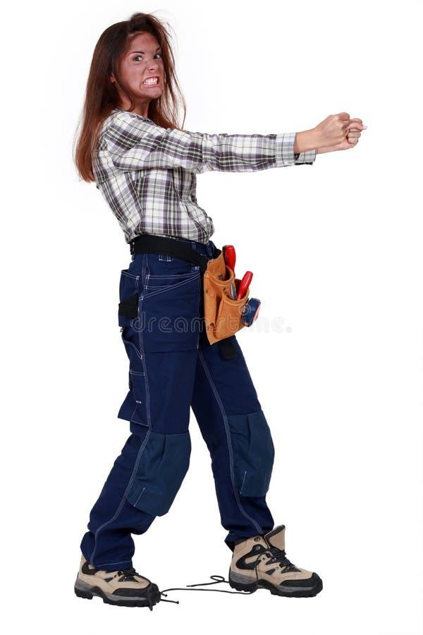 愤怒的女工 免版税库存图片