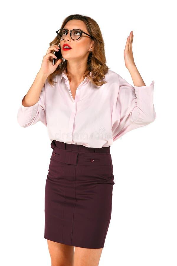 愤概企业夫人谈话在电话 免版税库存图片