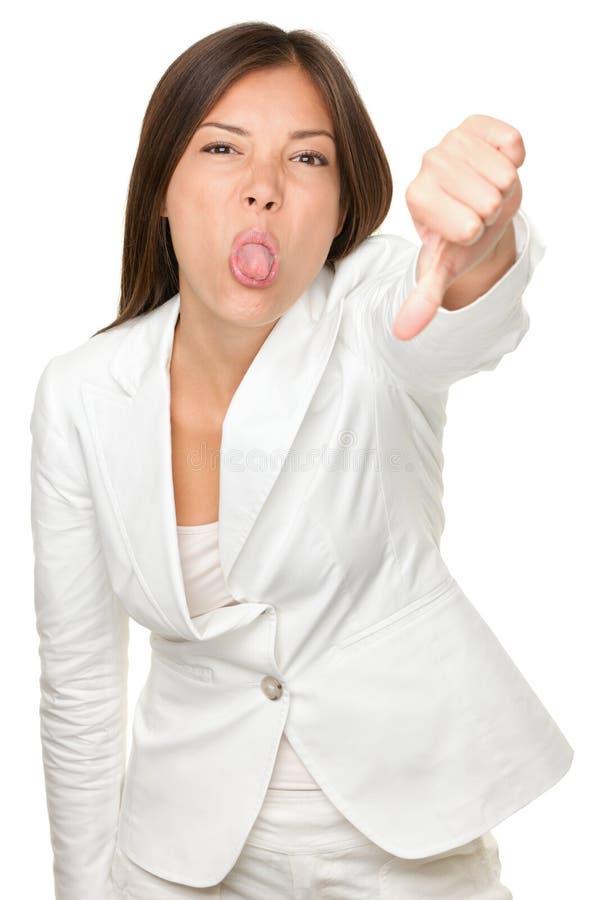 戏弄的女实业家,当打手势拇指下来时 库存照片