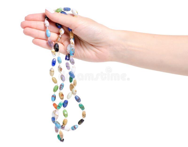 成串珠状手中五颜六色的石头 图库摄影