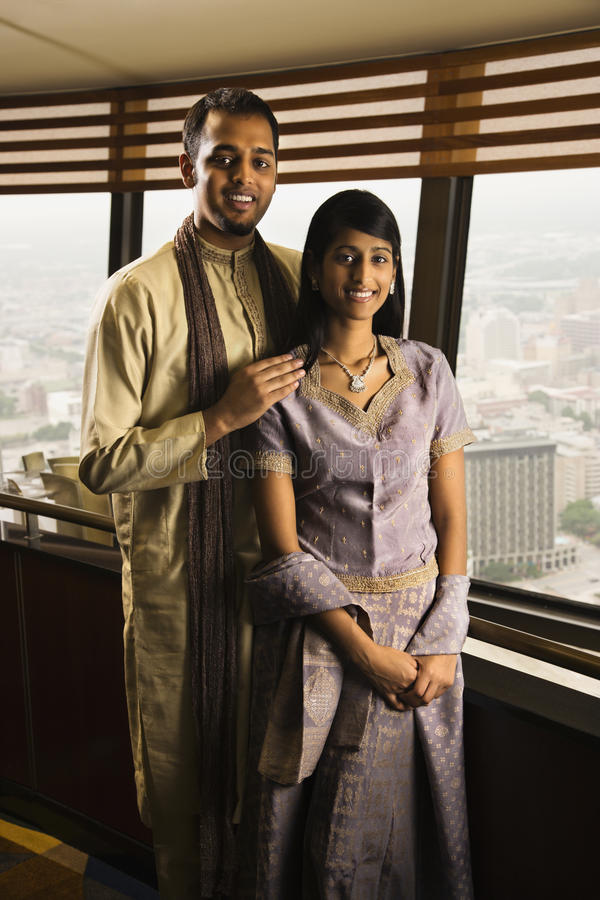 成人新夫妇高层的视窗 库存图片