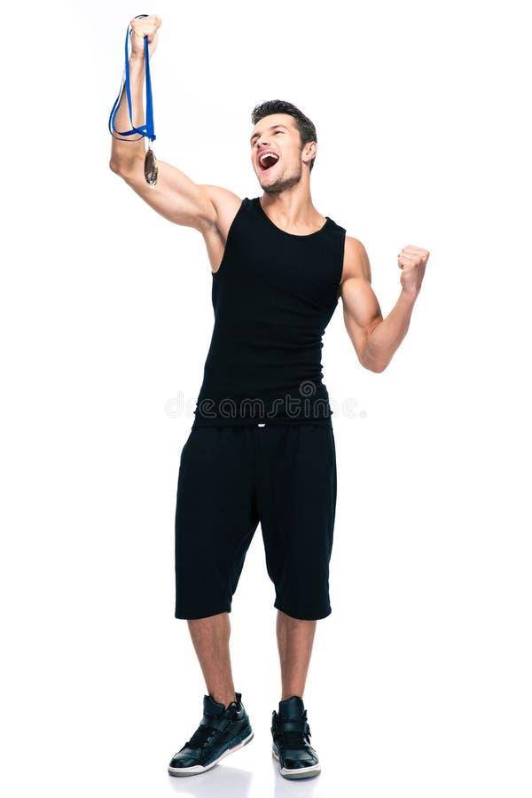 成功炫耀拿着优胜者奖牌的人 免版税库存照片