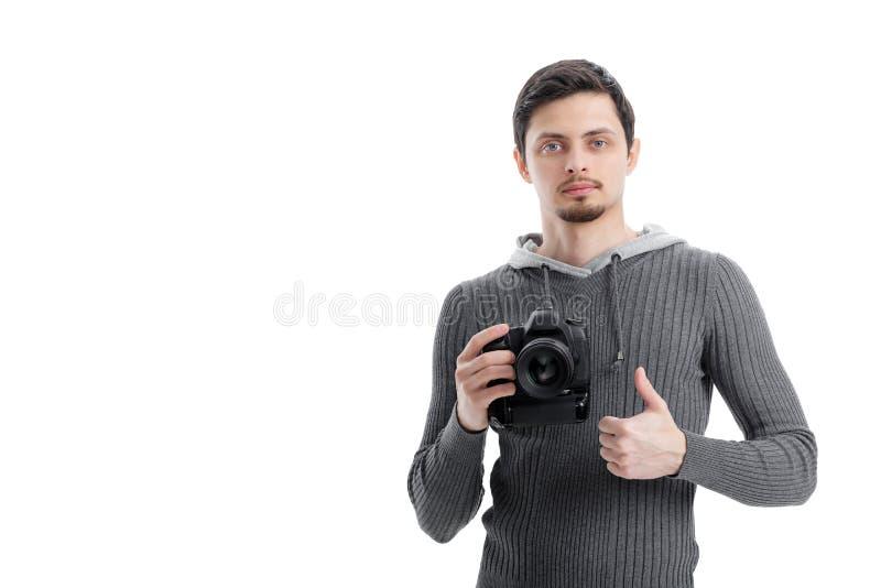 成功的专业摄影师用途DSLR数字照相机和 免版税库存图片