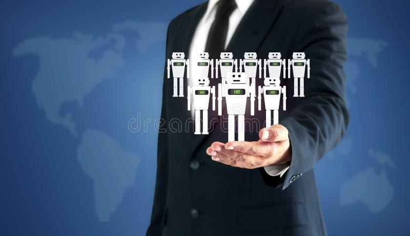 成功的商人手接触真正机器人AI代表人的工作的一个替补 免版税库存图片