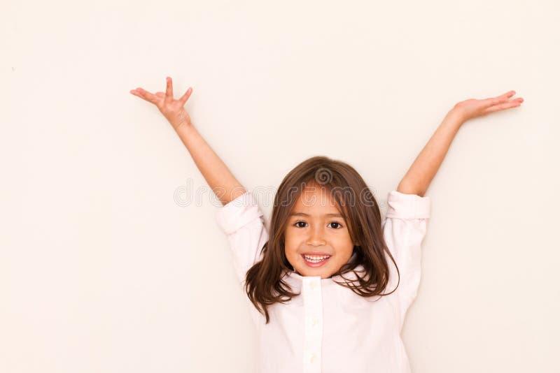 成功,愉快小女孩使用 库存图片