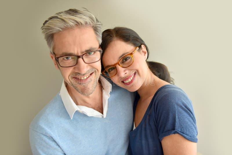 成熟夫妇佩带的镜片 库存图片