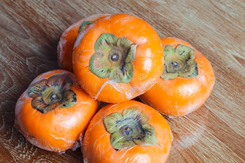 成熟日本柿子 免版税库存照片