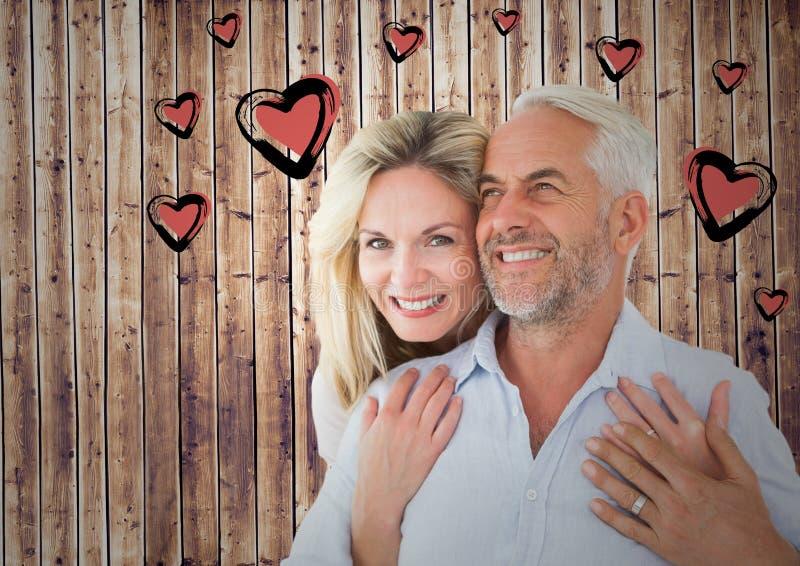 成熟浪漫夫妇和心脏图表 免版税库存照片