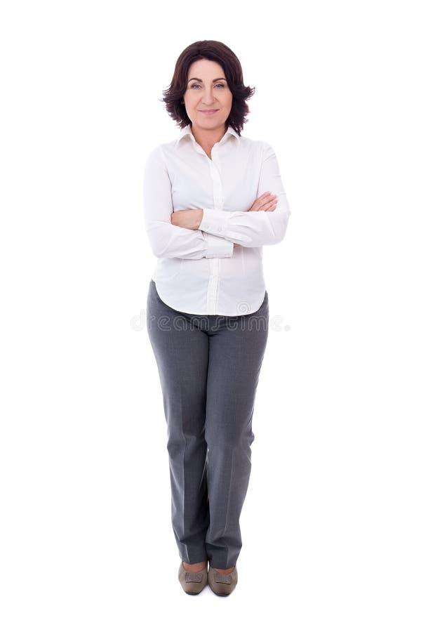 成熟的商业妇女全长画象在白色隔绝的 库存照片