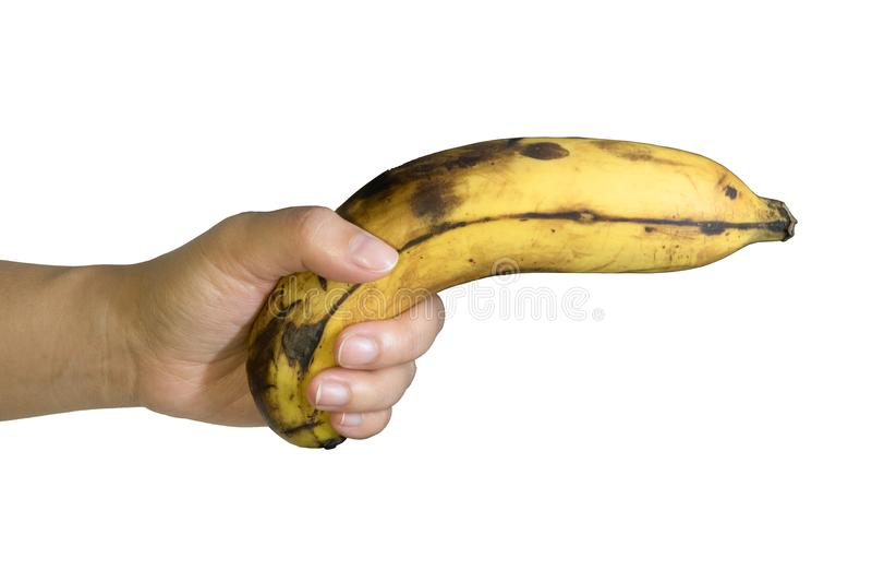 成熟香蕉果子枪举行在手中 图库摄影