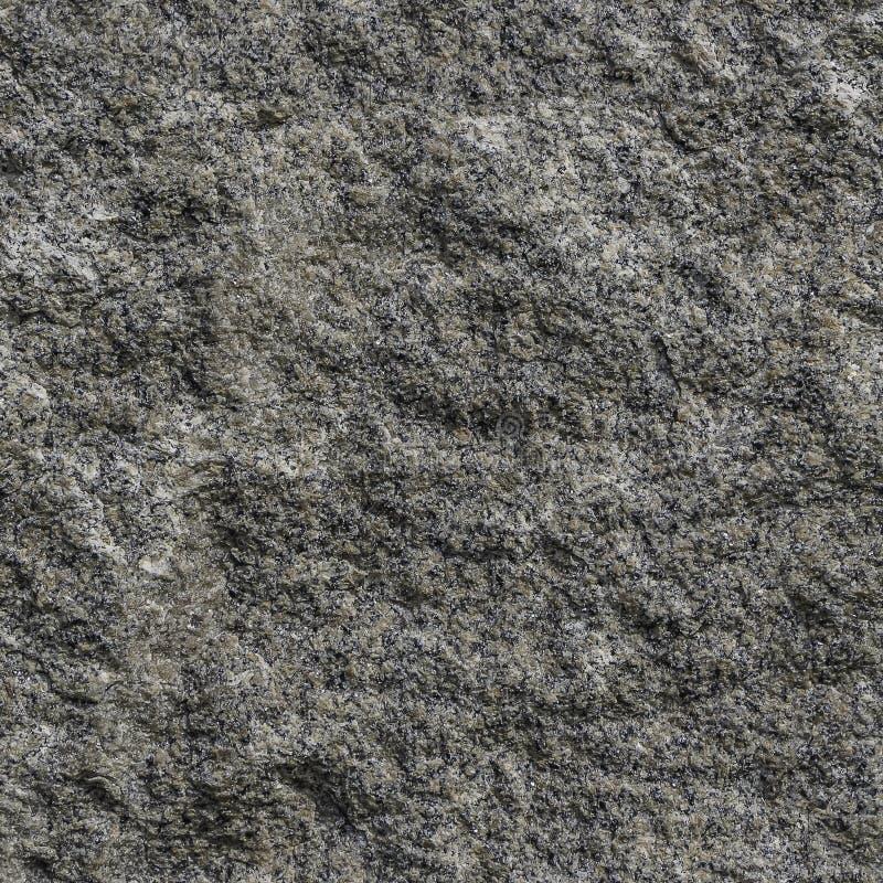 我们在照片看自然灰色和黄色花岗岩石表面的无缝的样式纹理  免版税库存照片