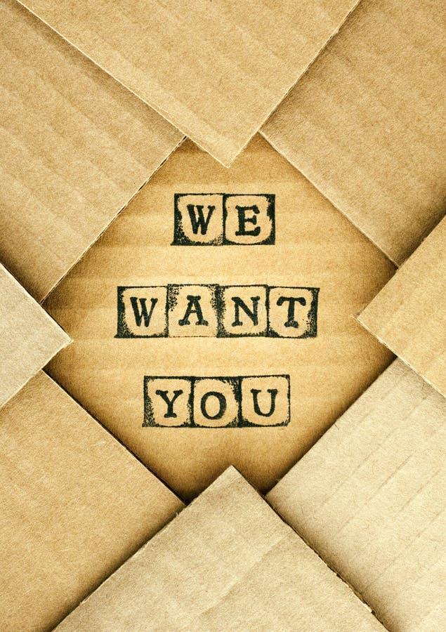 我们想要您的词由黑字母表邮票做在纸板 免版税图库摄影