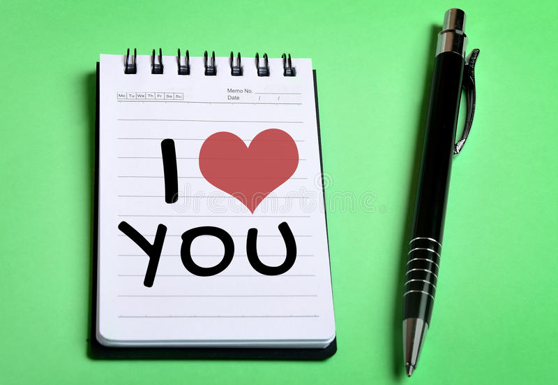 我爱你在笔记本的词 免版税库存图片
