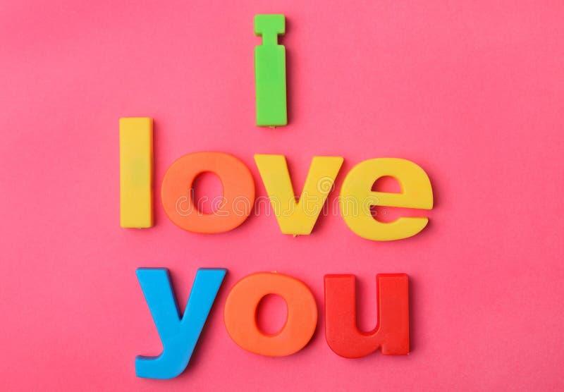 我爱你在背景的词 库存图片
