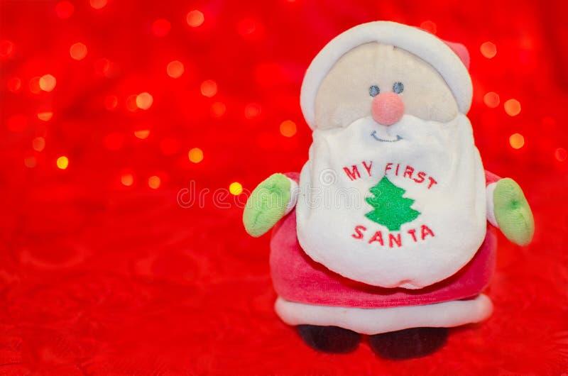 我的在红色bokeh背景的第一圣诞老人 库存图片