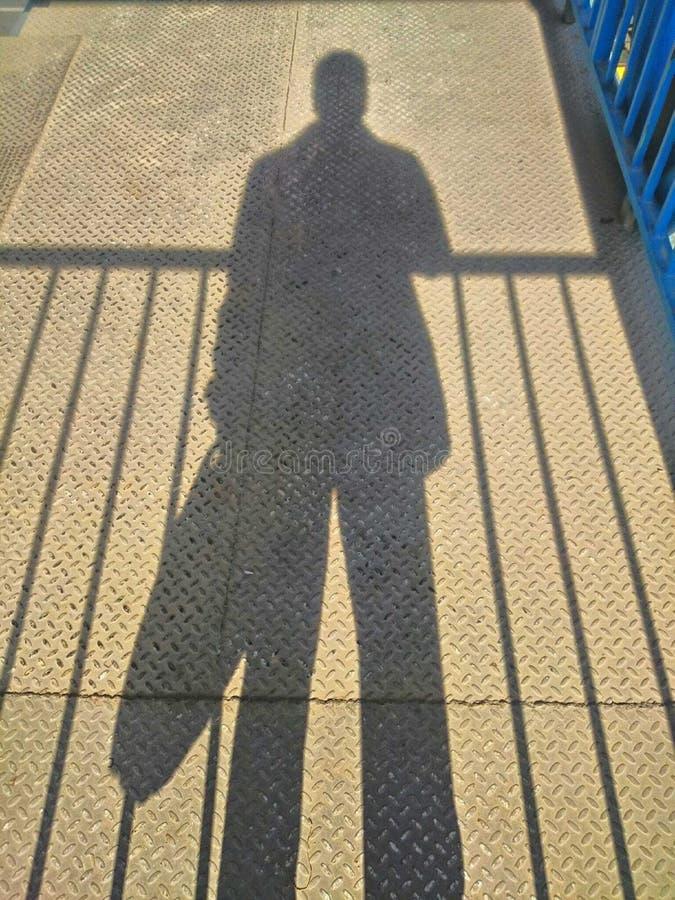 我的阴影比我更是压下事务 库存照片