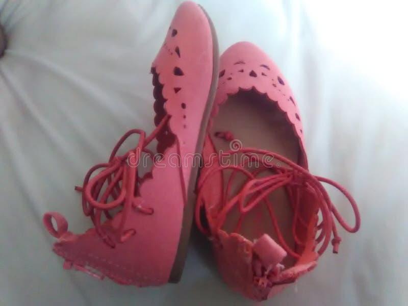 我的婴孩化装舞会服装鞋子 免版税图库摄影