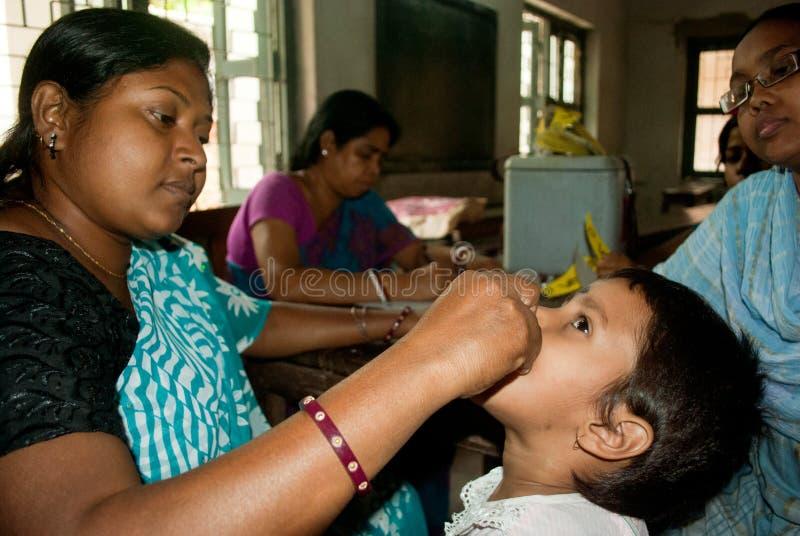 我们根除小儿麻痹症 库存图片