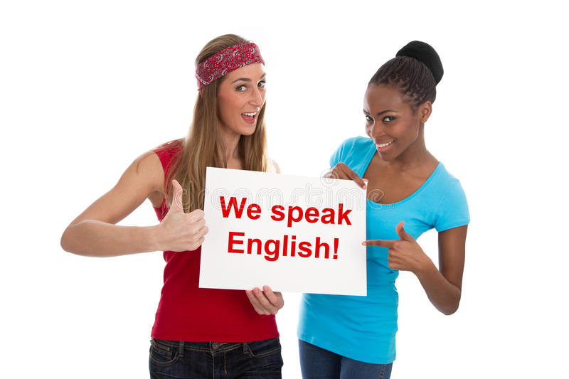我们讲英语-在白色隔绝的两名妇女 库存图片
