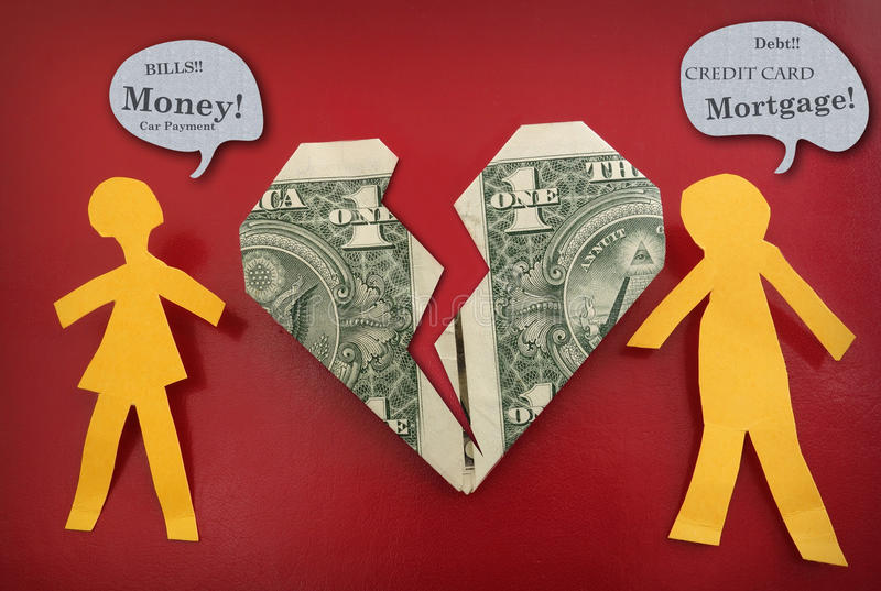 战斗关于金钱的夫妇 免版税库存照片
