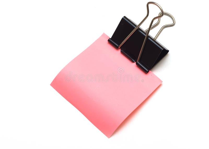 截去纸桃红色纯贴纸 库存照片