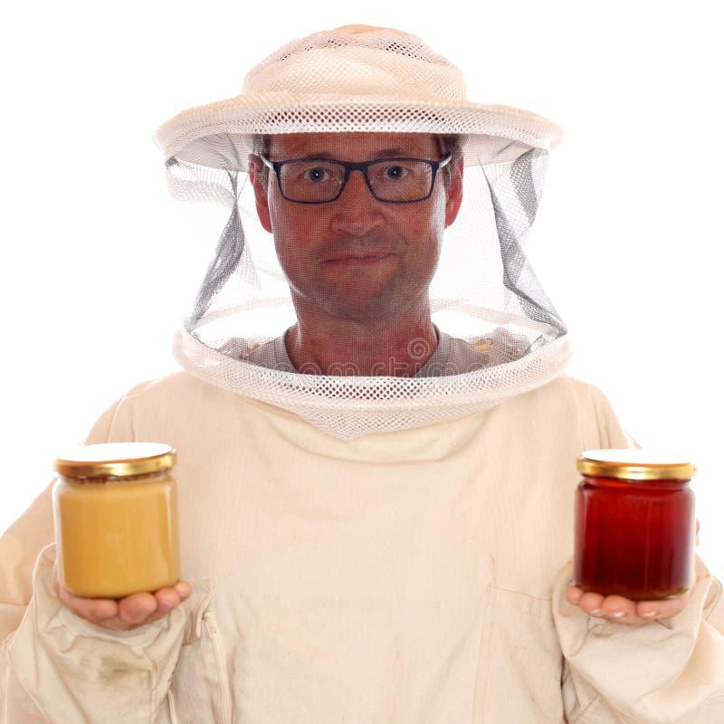 戴蜂蜜眼镜的养蜂家 免版税库存图片
