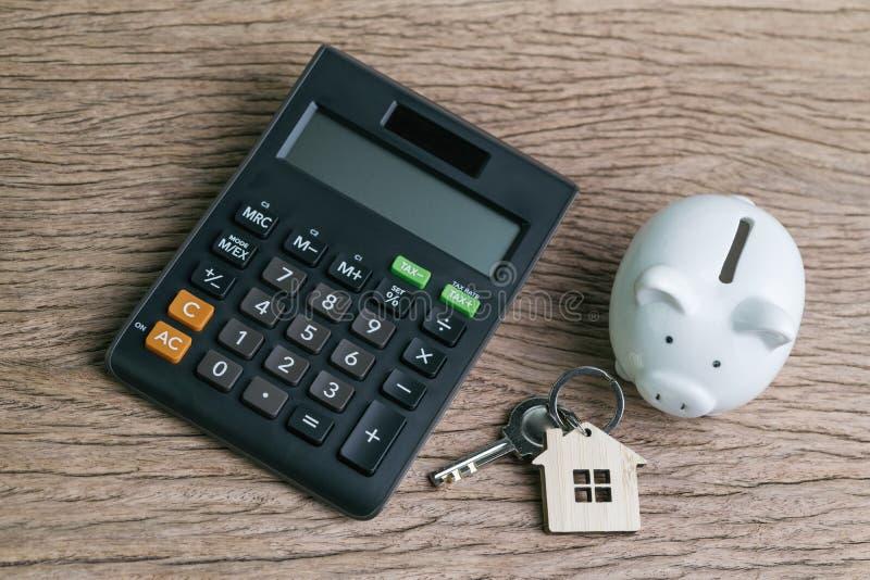 房子或房屋贷款和贷款演算骗局的攒钱 库存照片