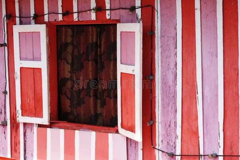 房子桃红色红色白色 库存照片