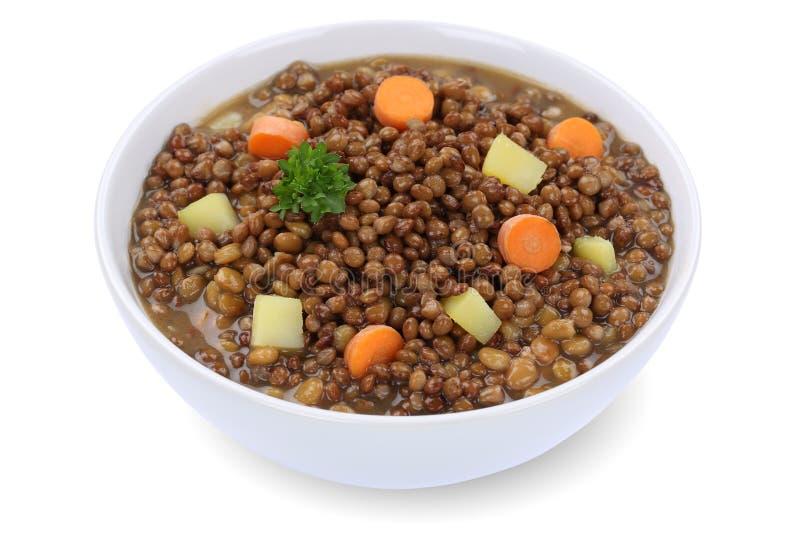 扁豆汤炖煮的食物用在被隔绝的碗的扁豆 免版税库存照片