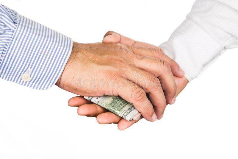 手与腐败现金交换的震动成交 库存图片