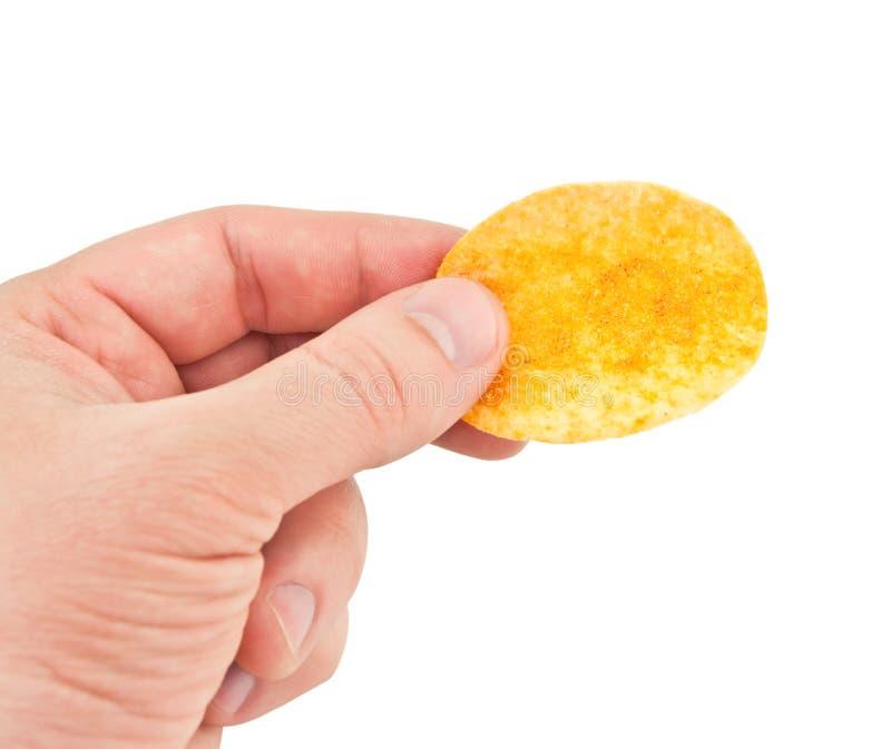 手中的土豆片 免版税图库摄影