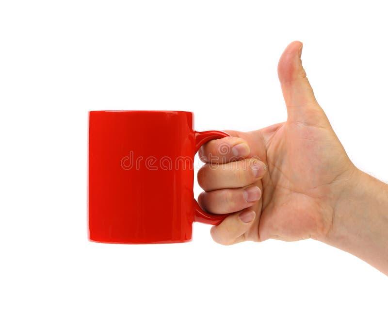 手举行红色杯子。 库存图片