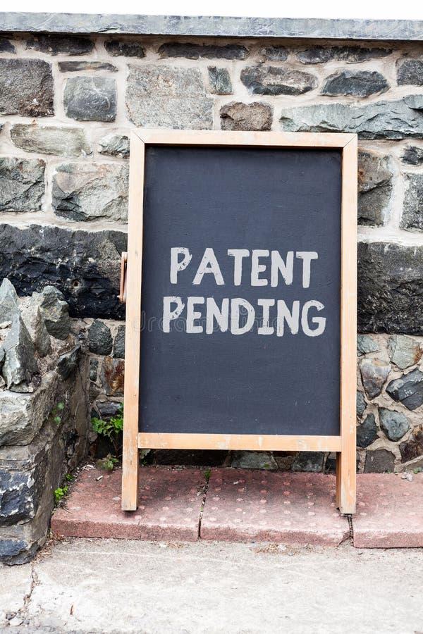 手写文本专利审理文字的 概念意思请求已经归档了,但是不授予追求保护 免版税库存图片