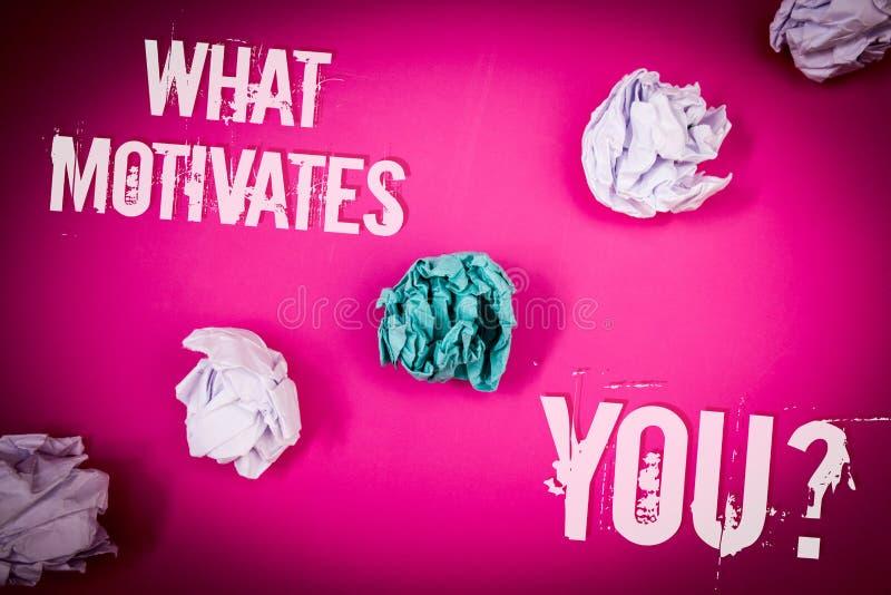 手写文本什么激发您问题 概念意思激情推进刺激性梦想志向浅粉红色的地板盘旋了嘘 图库摄影