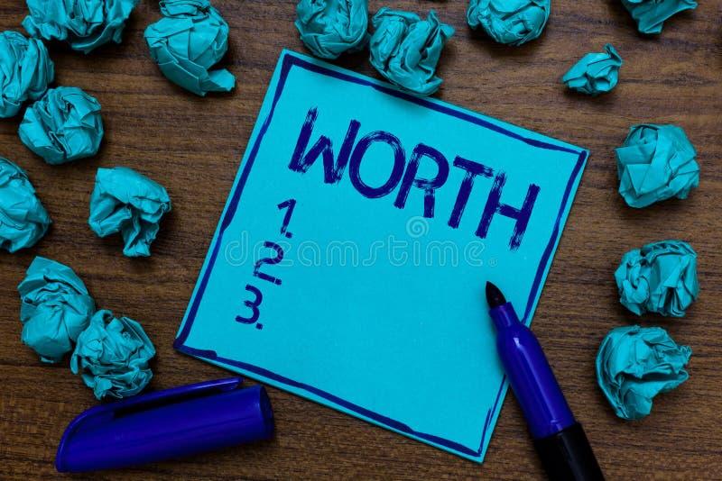 手写文本价值 概念个人和财政意义重要性深蓝纸想象力想法的意思测量 免版税库存图片